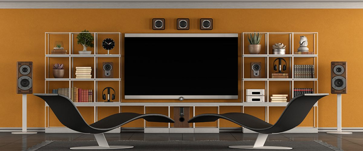 Modern living room with home cinema system with large flat screen,bookcase and two chaise lounges - 3d rendering